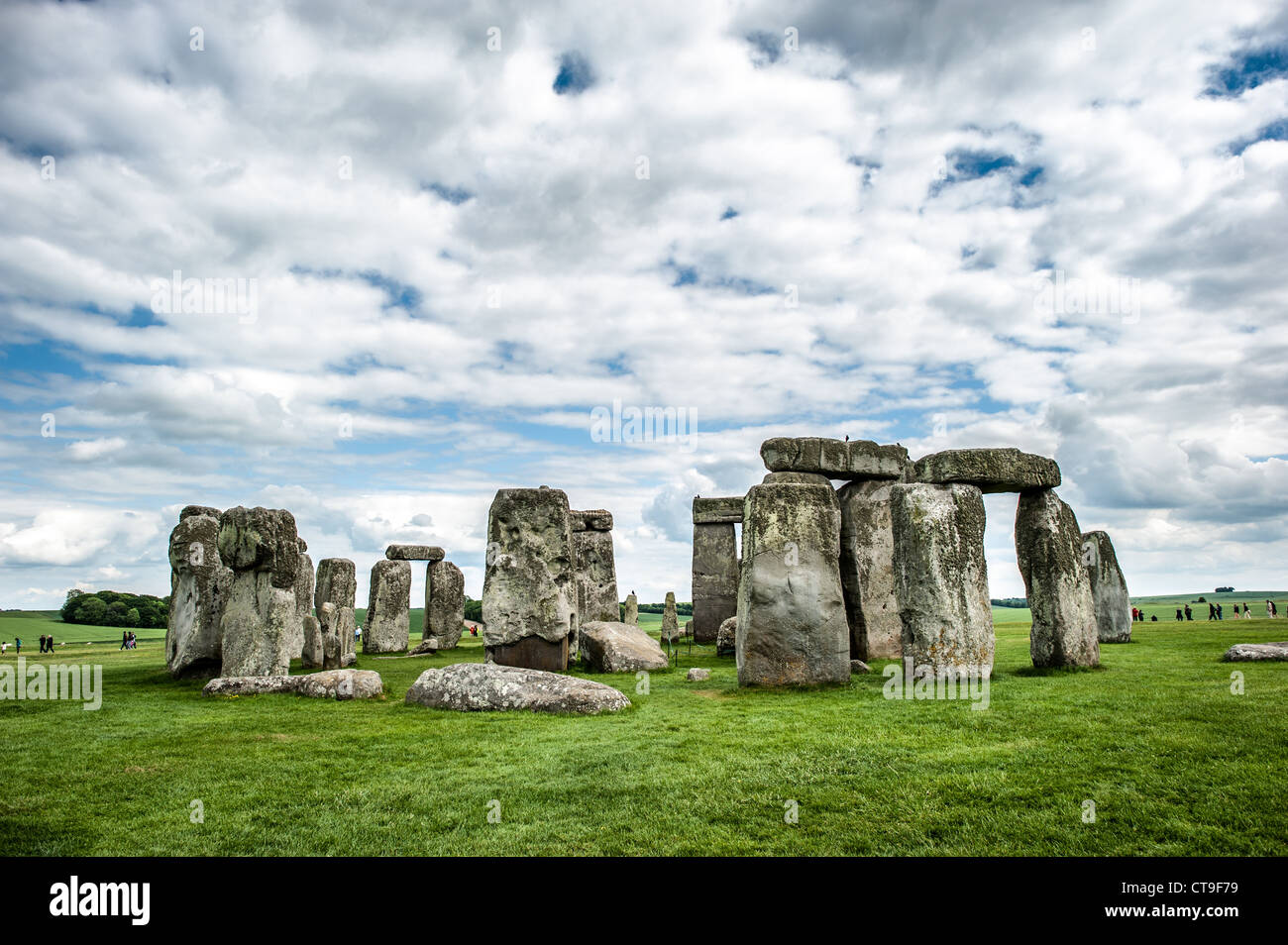 STONEHENGE, UK - LONDON, UK - Stonehenge with Partly Cloudy Sky. Believed to have been built somewhere between 2000 Stock Photo