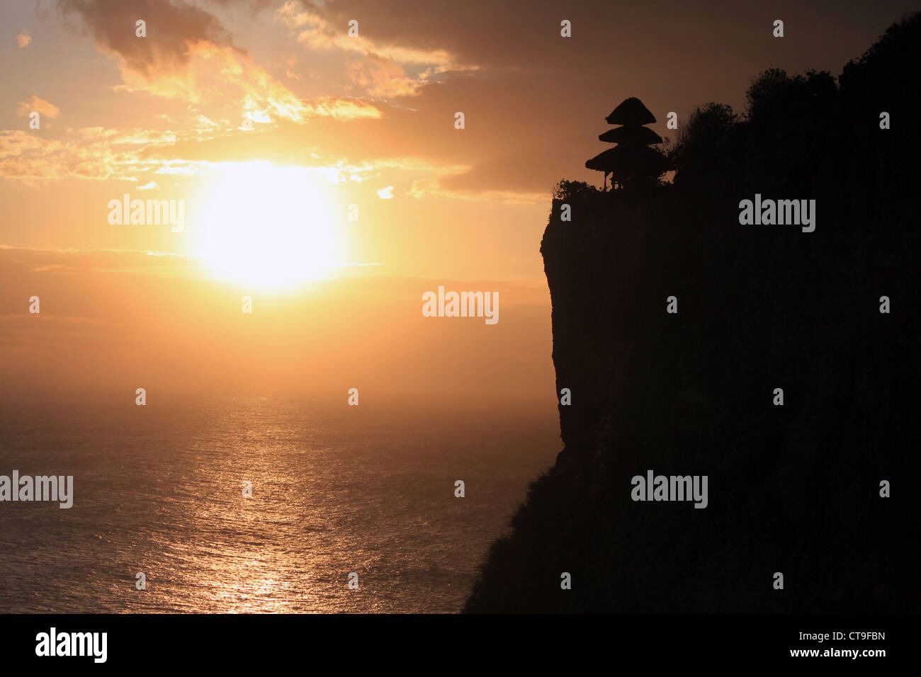 Uluwatu Temple (Pura Luhur Uluwatu) on the south western tip of Bali at sunset. - Stock Image