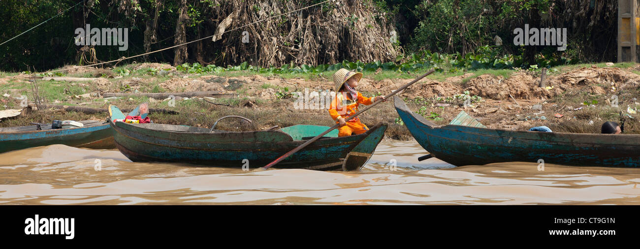 """Wooden boat with child on the Tonle Sap Lake, the """"Great Lake""""  Cambodia, Stock Photo"""