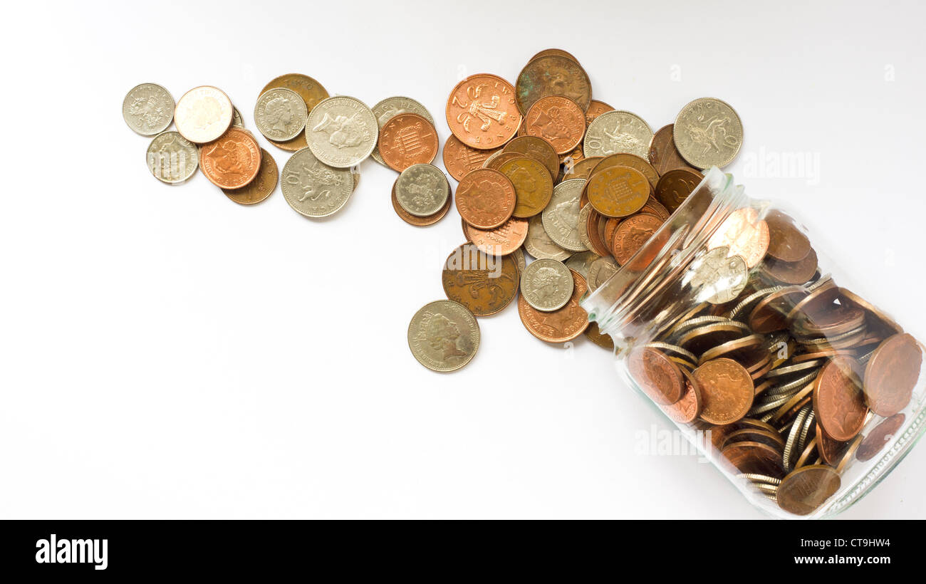 glass money jar with coins - Stock Image