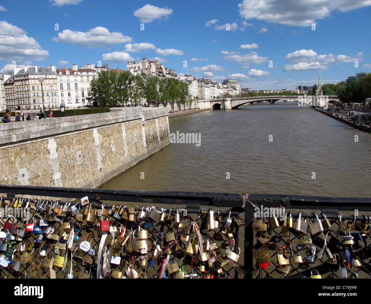 Love padlock on Pont de l'Archeveche bridge on the Seine river,Paris,France,Sainte Genevieve bridge and ile - Stock Image