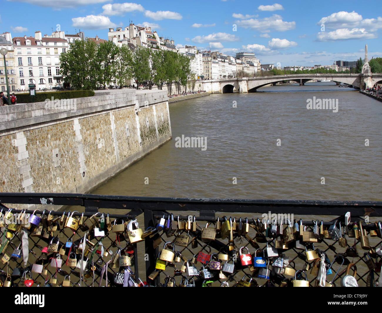 Love padlock on Pont de l'Archeveche bridge on the Seine river,Paris,France,Sainte Genevieve bridge and ile Saint Stock Photo