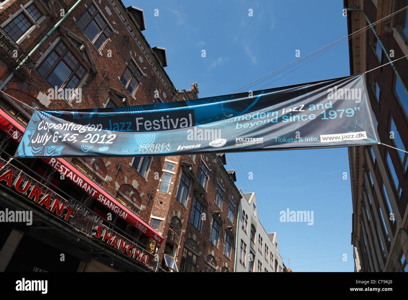The Copenhagen Jazz Festival 2012 banner across the pedestrian and shopping street Strøget in Copenhagen, Denmark - Stock Image