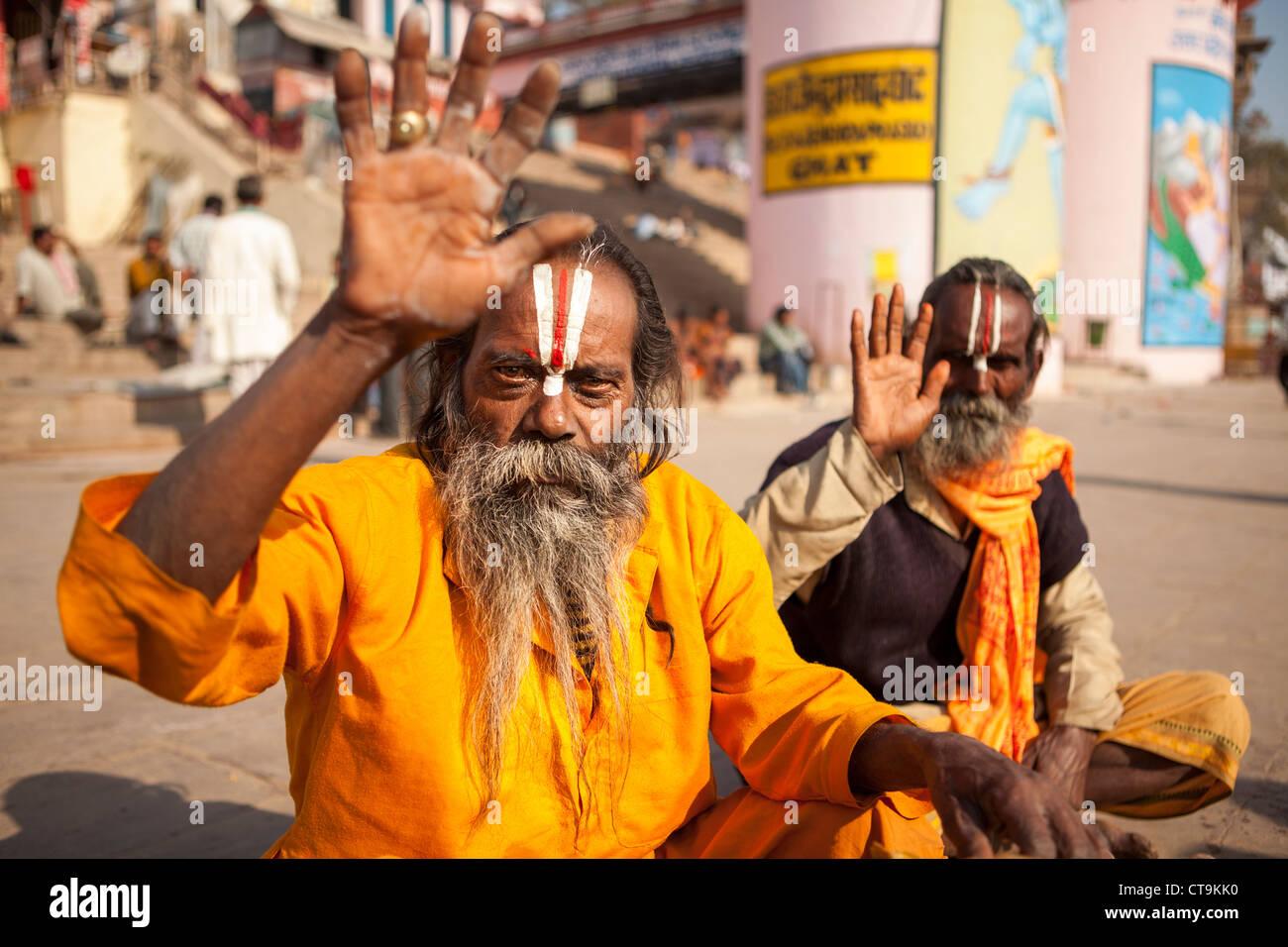 The holy man Sadhu hand up for greeting , Varanasi, Uttar Pradesh, India - Stock Image