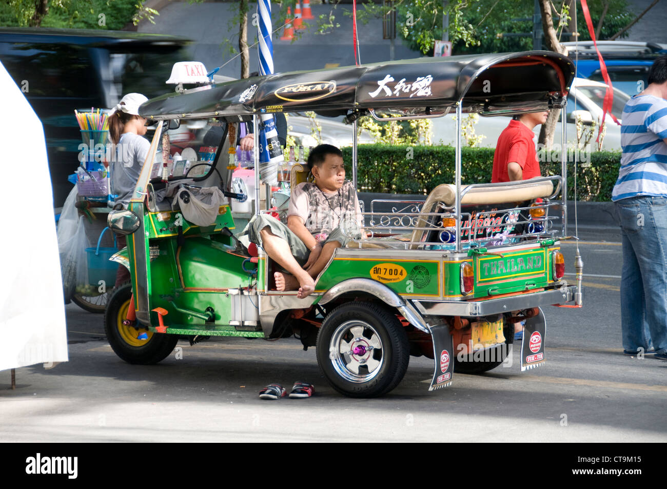 A tut-tut driver waiting for costumers in Bangkok, Thailand - Stock Image