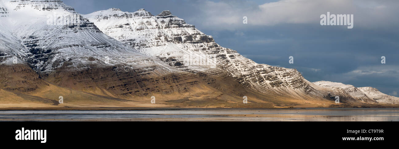 Snow-covered mountains of the east fjords. Iceland. - Stock Image