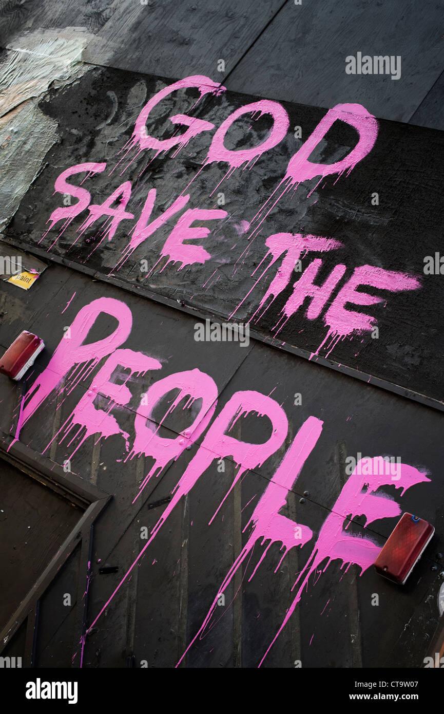God Save the People Graffiti. New Oxford Street. Holborn, London, England - Stock Image