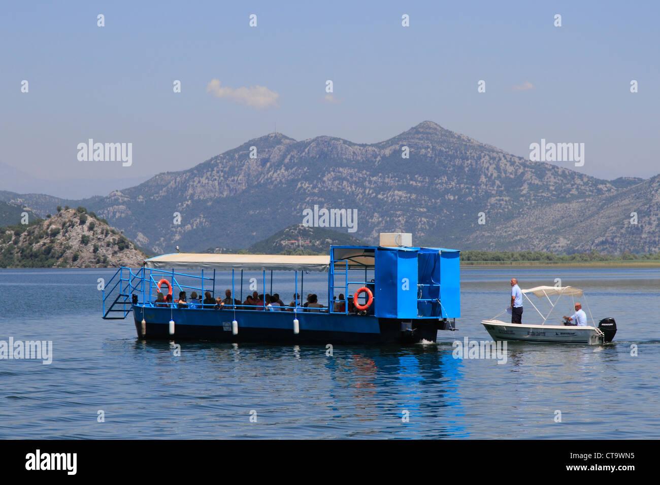 Montenegro, Skadar lake, national park officials check on boat - Stock Image
