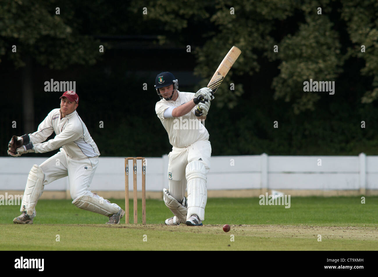 batsman  in action during an amateur cricket match between didsbury and oxton in the cheshire county premier league - Stock Image