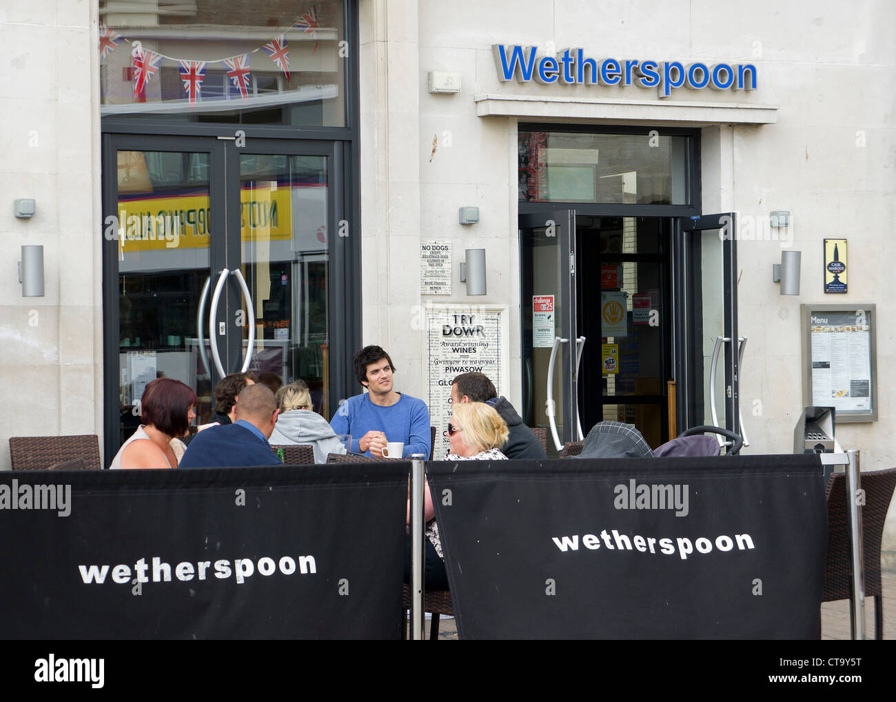 Customers seated outside a Wetherspoons pub in Truro, Cornwall, UK - Stock Image