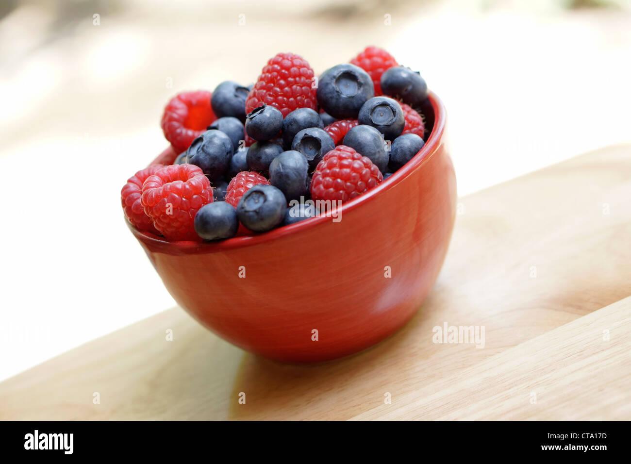Bowl Fruit, Raspberries Blueberries - Stock Image