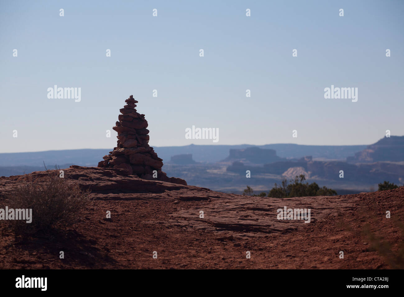 Rock cairn beside a trail in Arches National Park, Utah. - Stock Image