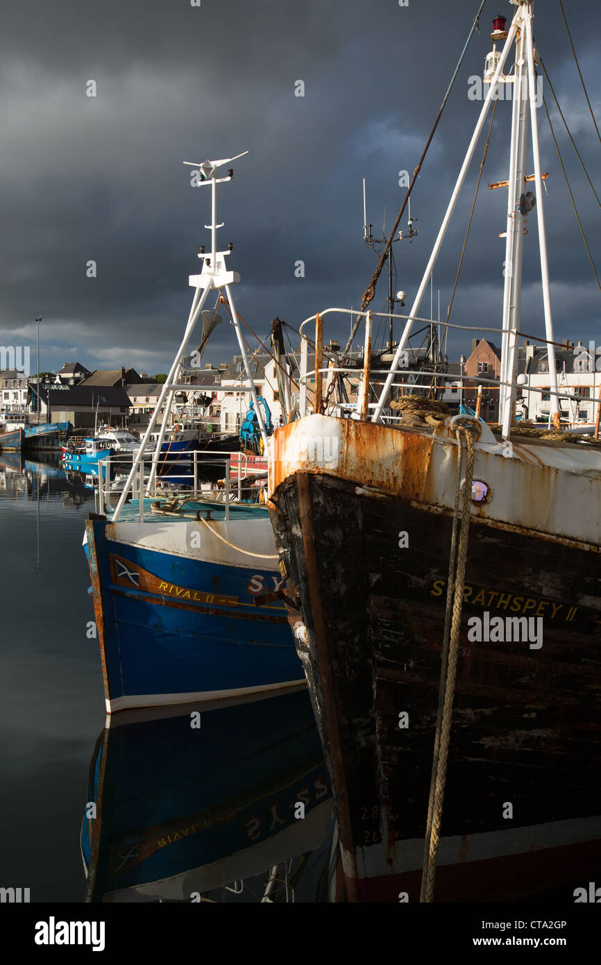 Town of Stornoway, Lewis. Picturesque evening view of the fishing fleet alongside Stornoway Harbour. - Stock Image