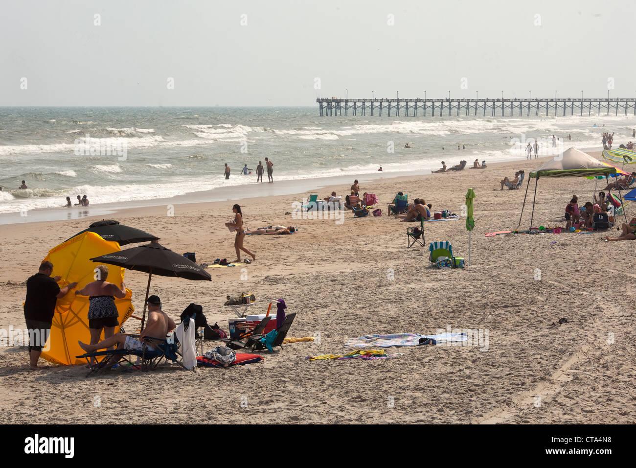 Tourists on Surf City beach , Topsail Island , North Carolina , USA - Stock Image