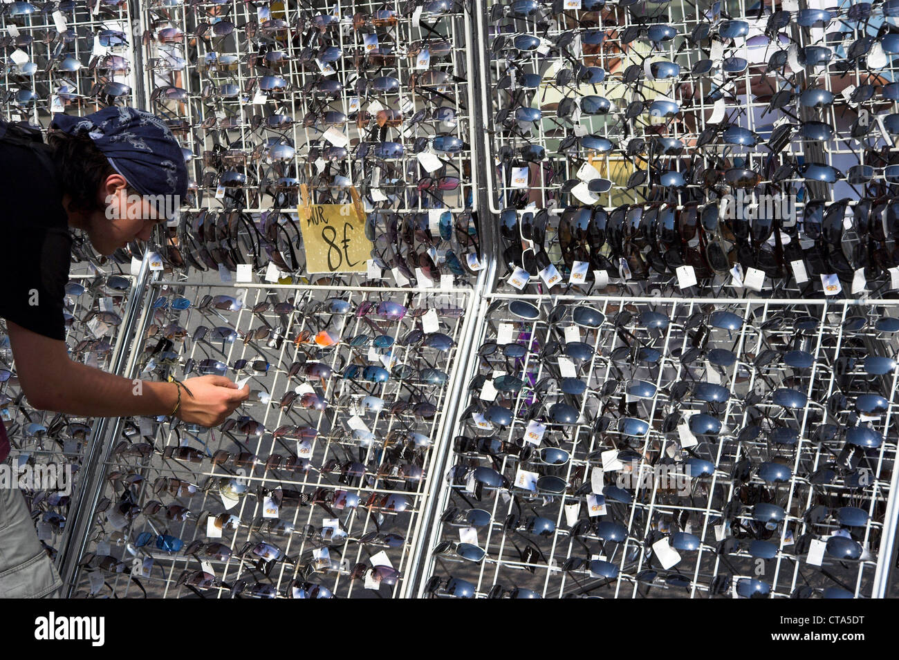 Dresden, tourist chooses a pair of sunglasses - Stock Image