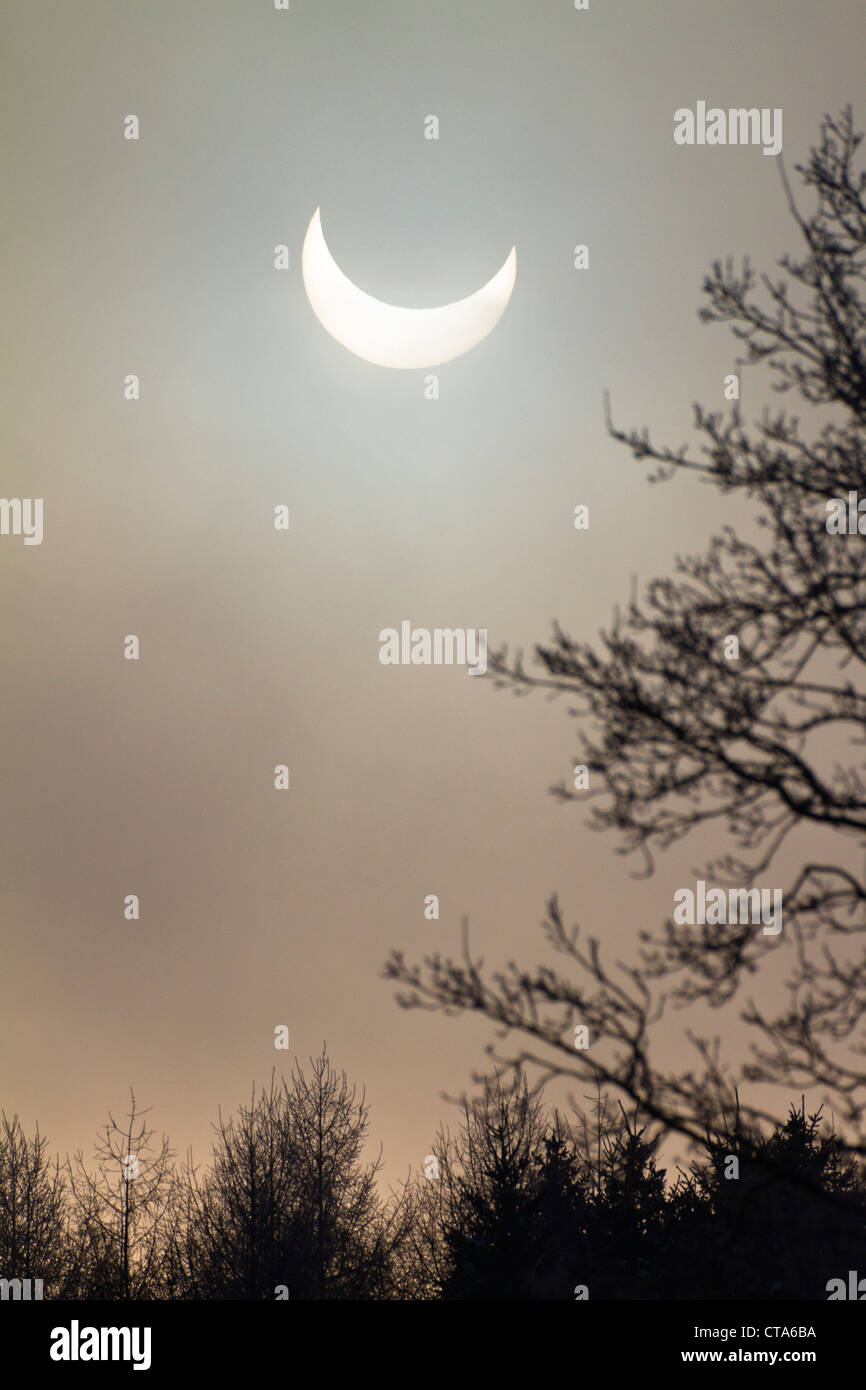 Partial solar eclipse (4th Jan 2011), Penzberg, Upper Bavaria, Germany - Stock Image