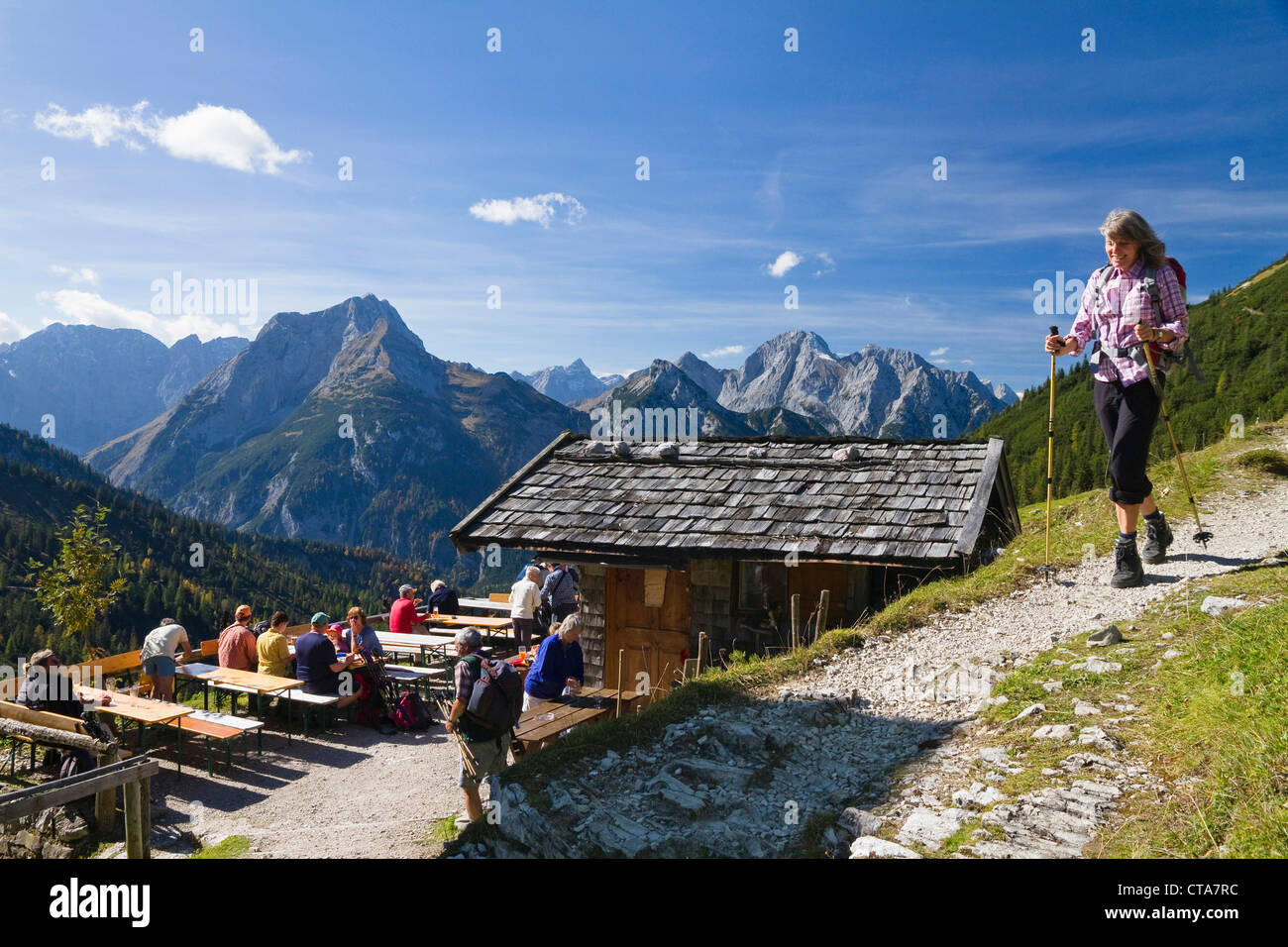 People at the terrace of mountain hut, Plumsjoch hut, Karwendel mountains, Tyrol, Austria, Europe - Stock Image