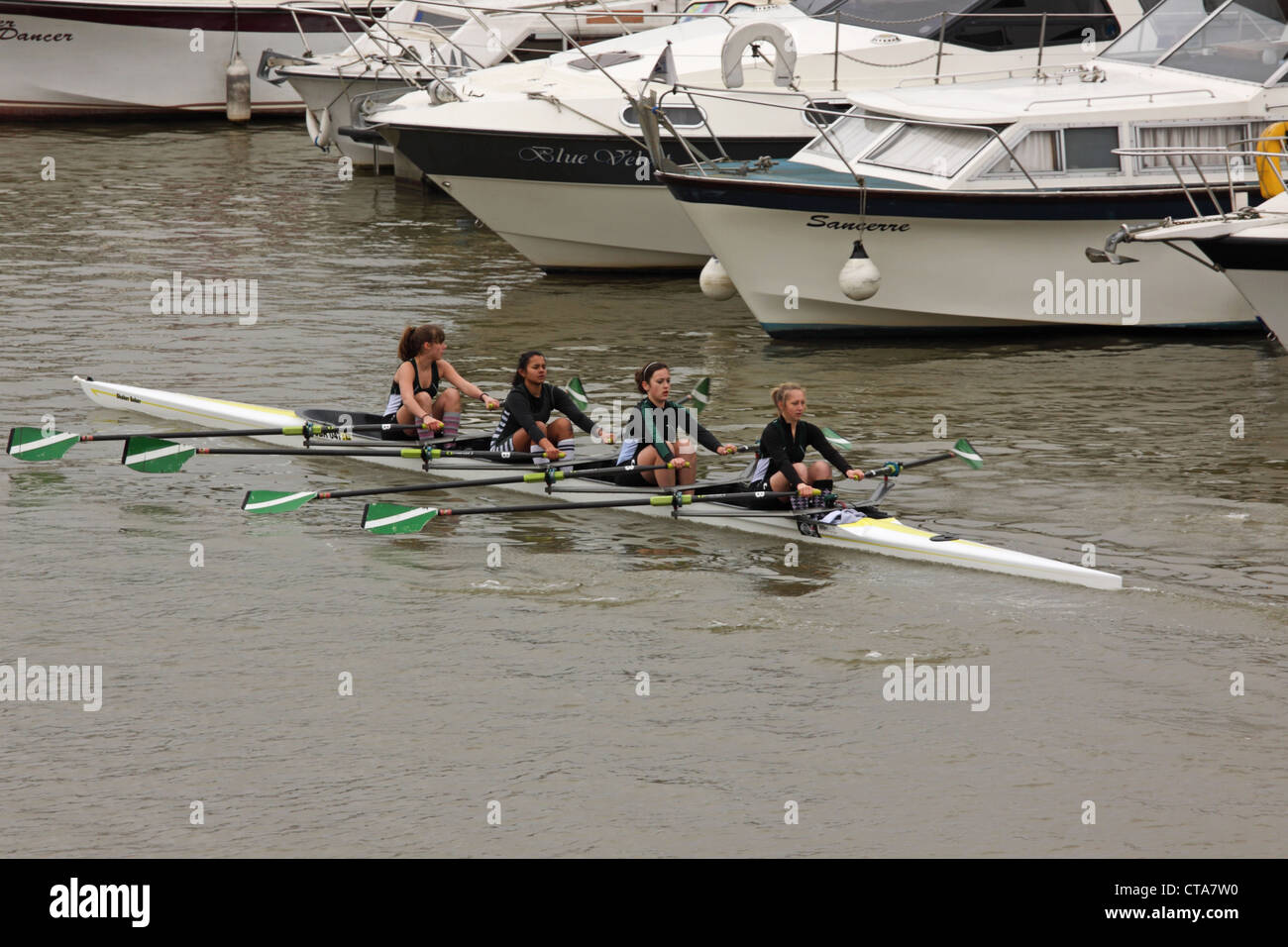 A young female coxless crew competing in a river race in Bristol UK - Stock Image