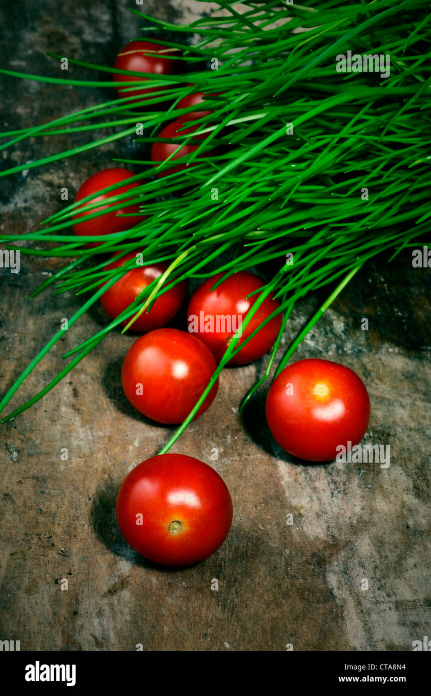 salad tomatoes in rustic setting Stock Photo