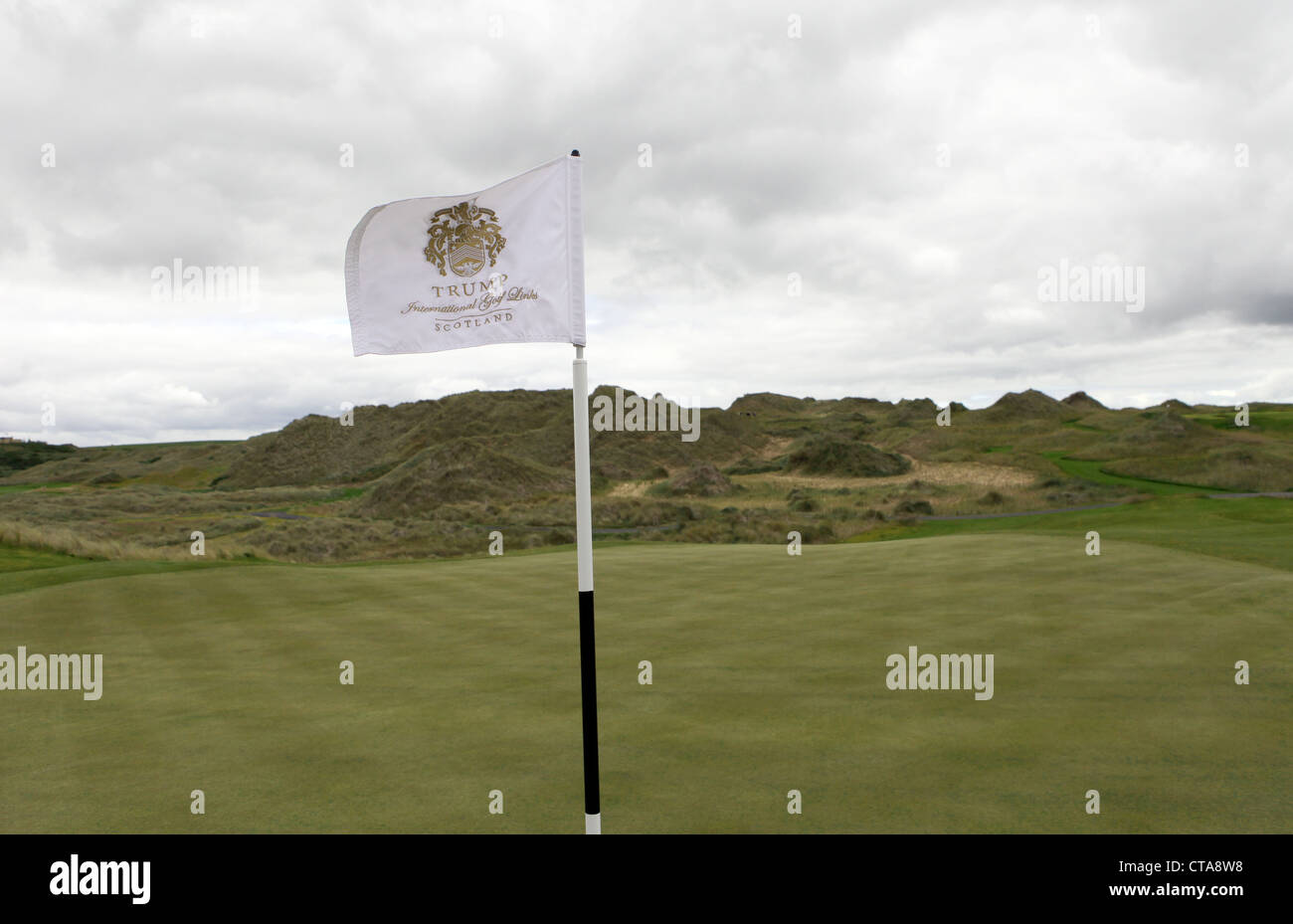 Flag on the new Trump International Golf Links course in Aberdeenshire, Scotland, UK. Owned by businessman Donald - Stock Image
