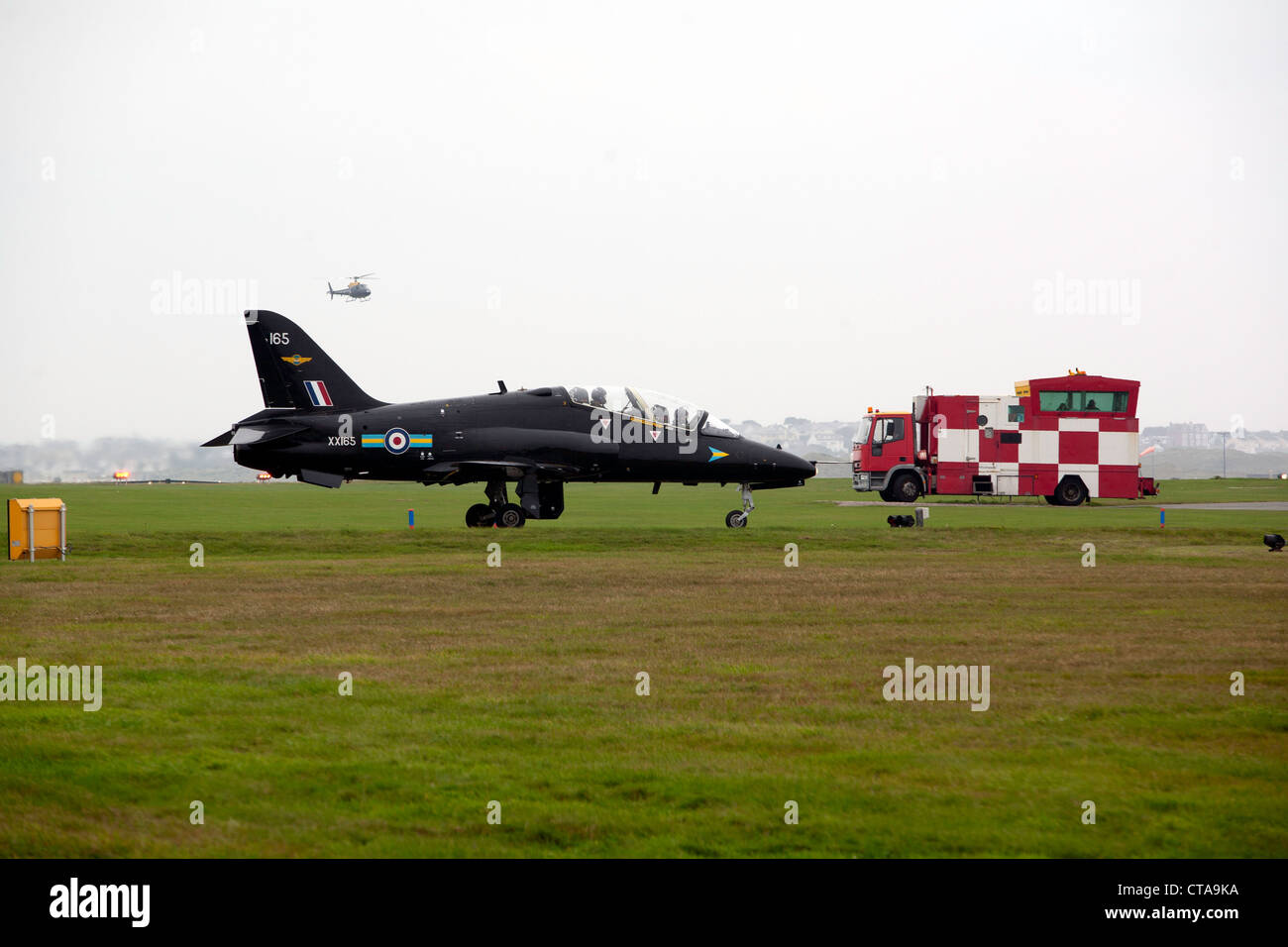 RAF Hawk T1 XX165 of 208 Squadron taxi's past the mobile ATC van at RAF Valley Pic Colin Paxton/CP Photography - Stock Image