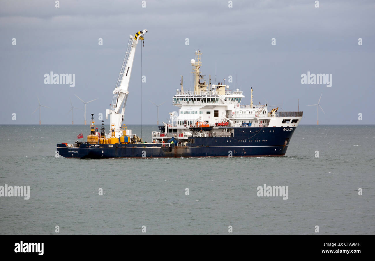 THV Galatea services a buoy off Rhos On Sea, North Wales - Stock Image