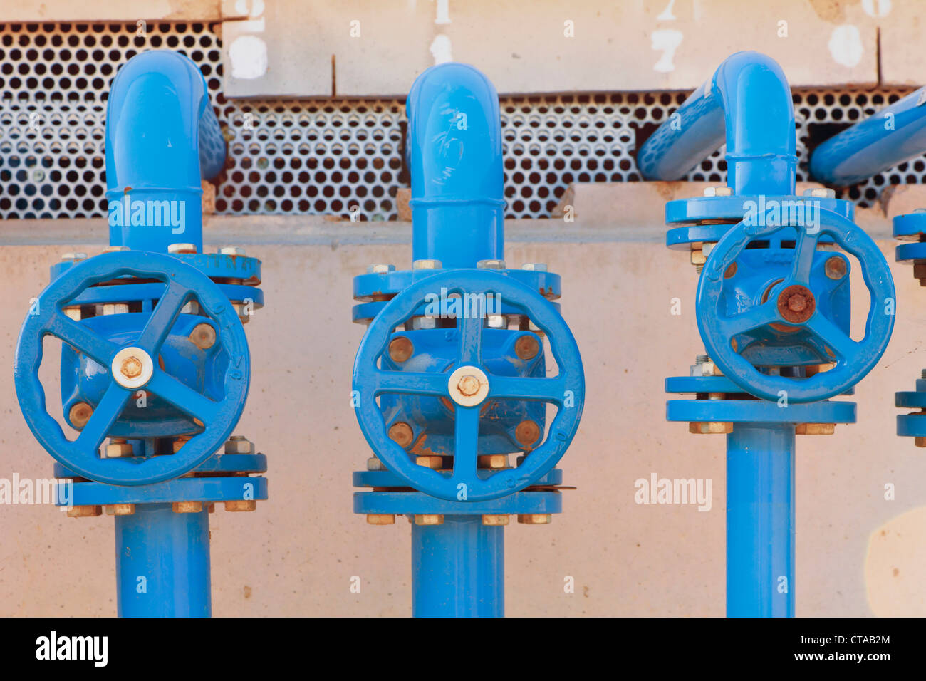Valves used to control water and chemical flow in hot houses, Huelva Province, Andalusia, southern Spain. - Stock Image