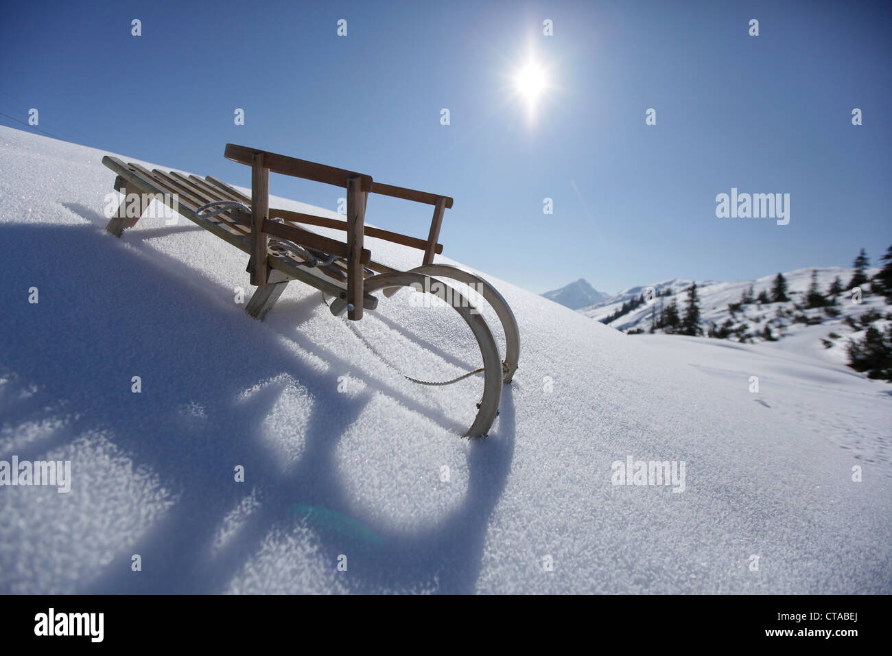 Sledge with back rest for young child, Kloesterle, Arlberg, Tyrol, Austria - Stock Image