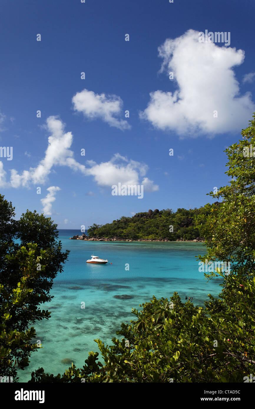 Boat in a bay in the sunlight, Baie Ste Anne, Anse Petit Cour, Praslin, Seychelles, Indian Ocean Stock Photo
