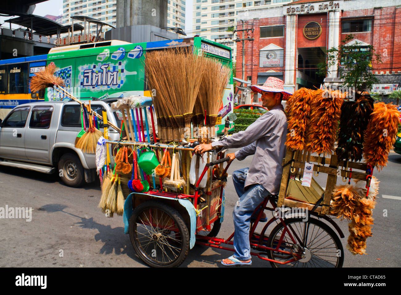 Mobile trader with feather dusters and brushes, Bangkok, Thailand, Asia - Stock Image