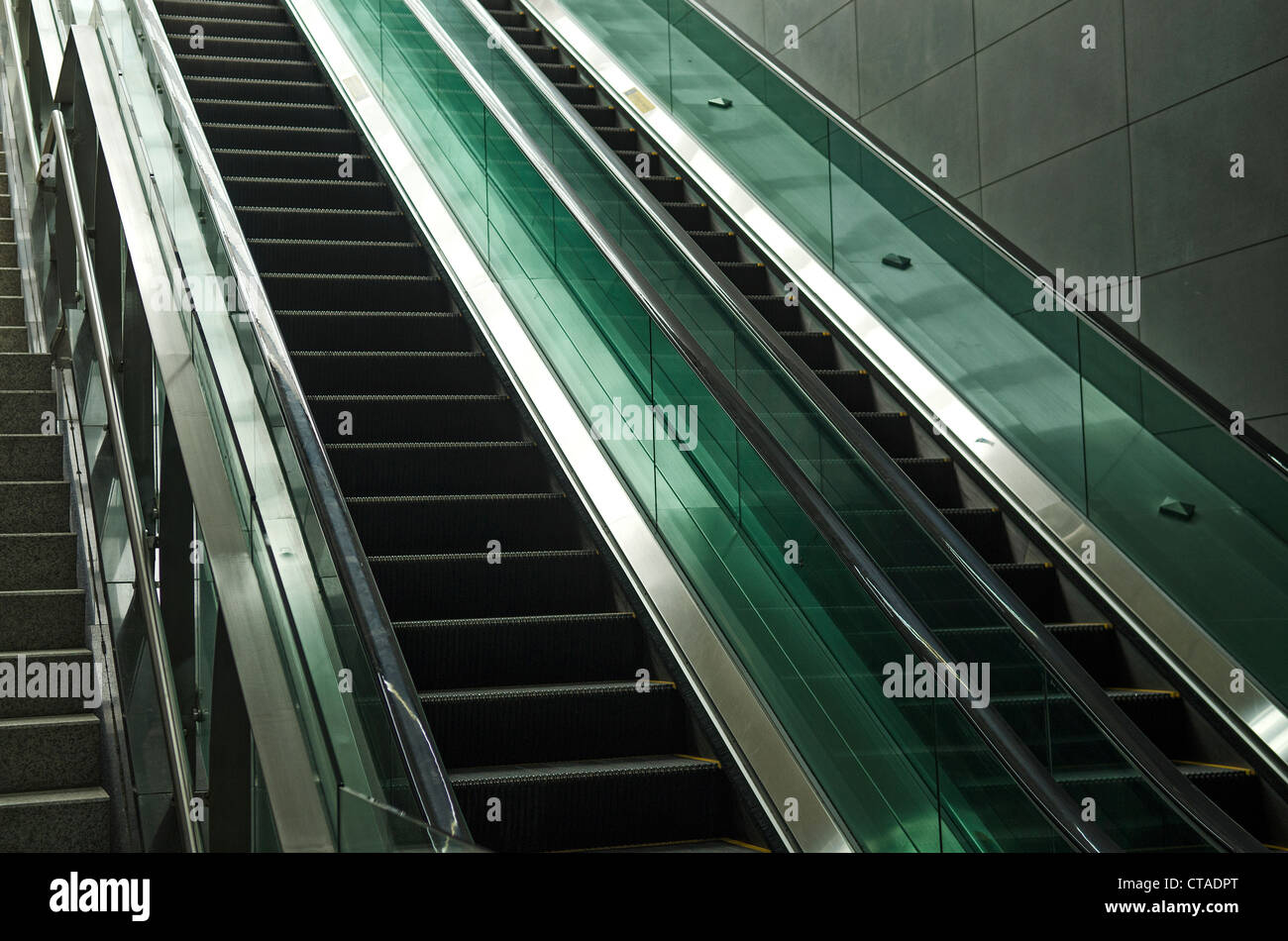 detail of modern glass and metal escalator - Stock Image