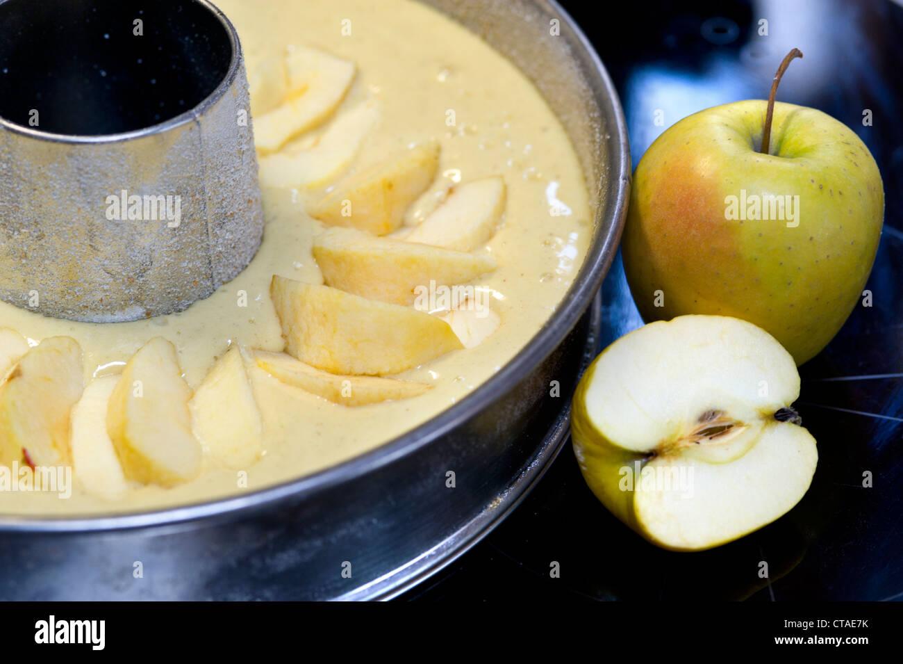 Appels near baking tin with dough, Apple pie, South Tyrol, Trentino-Alto Adige, Italy - Stock Image