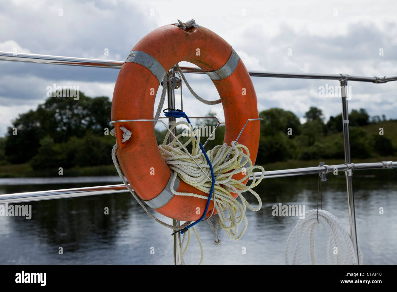 View of a lifebelt at the rear of a boat - Stock Image
