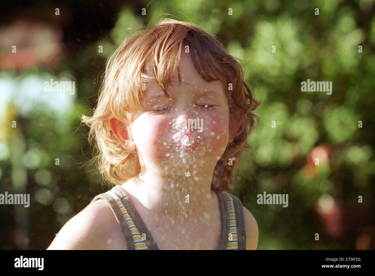 Berlin, a child playing with water - Stock Image