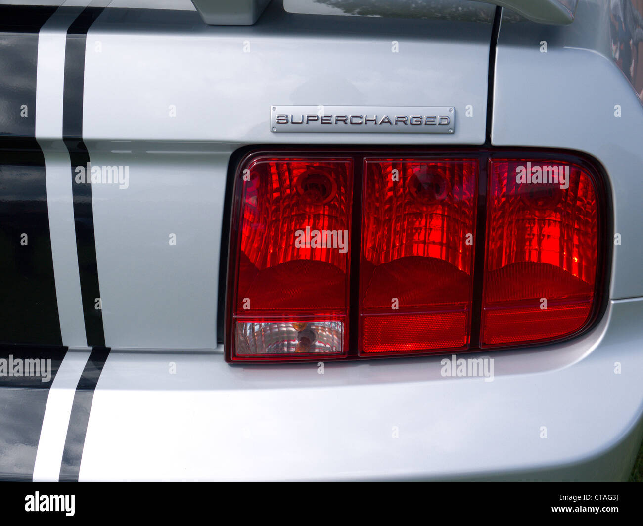 Late model, supercharged Ford Mustang tail lights and badge - Stock Image