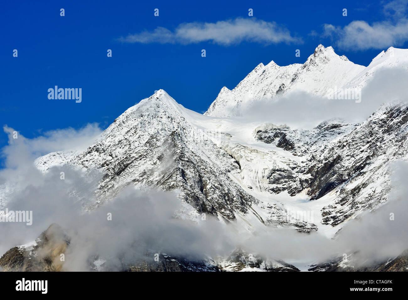 Snow-covered Himalayan mountains above Keylong, Himachal Pradesh, India - Stock Image