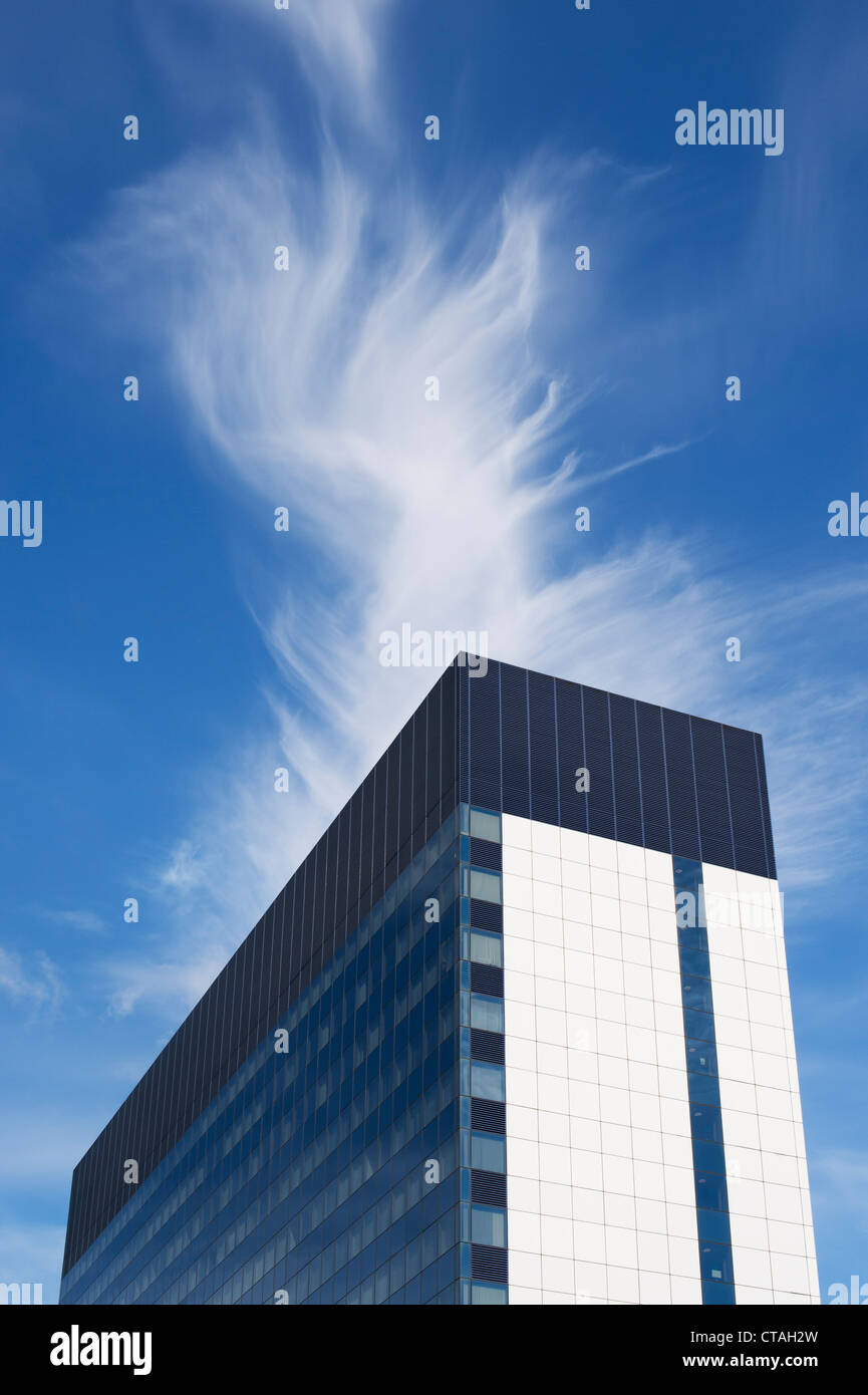 Cirrus cloud above London office block - Stock Image