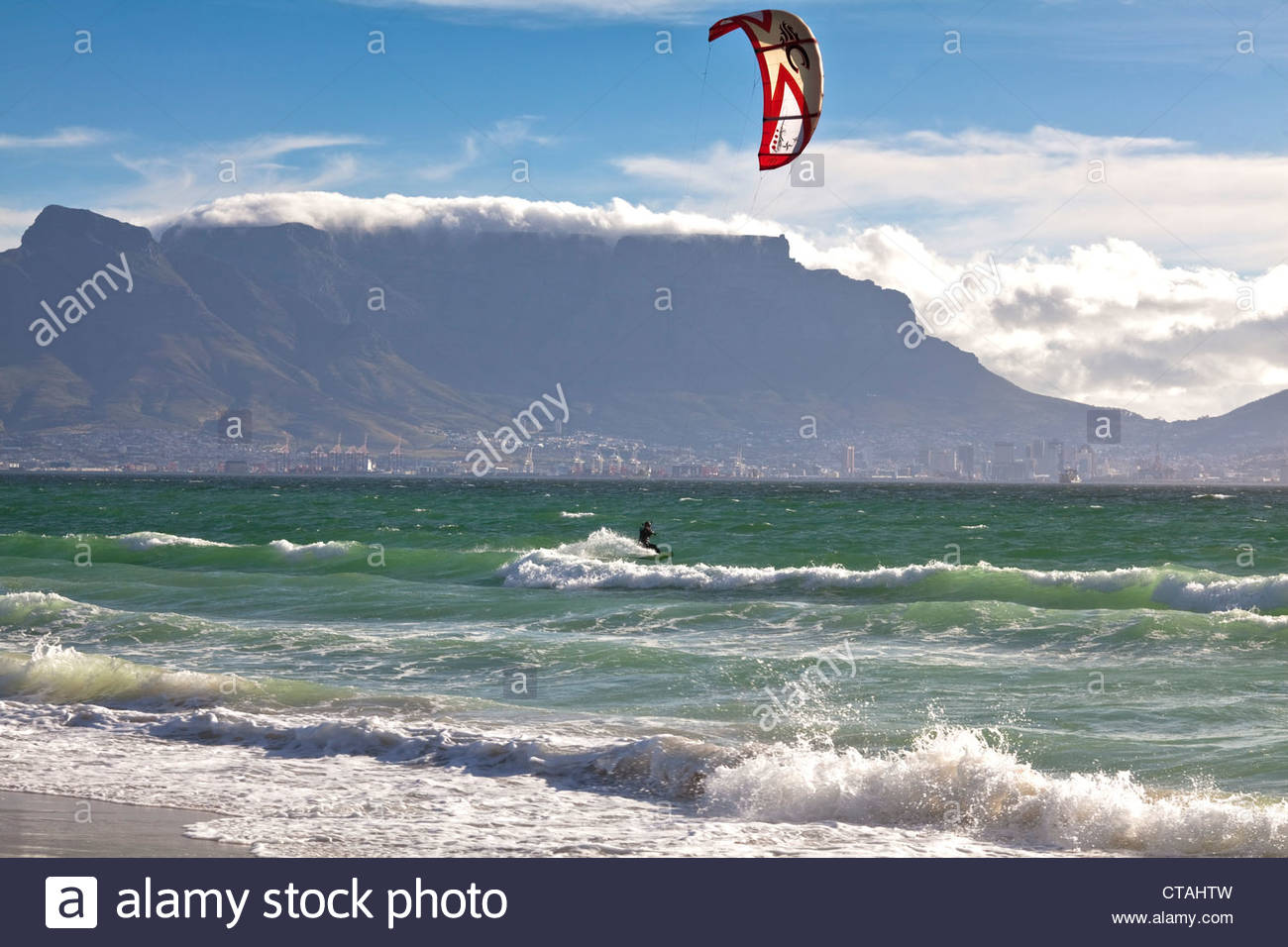 Beach impression with kitesurfers at Bloubergstrand with views of Table Mountain and Cape Town, Western Cape, South - Stock Image