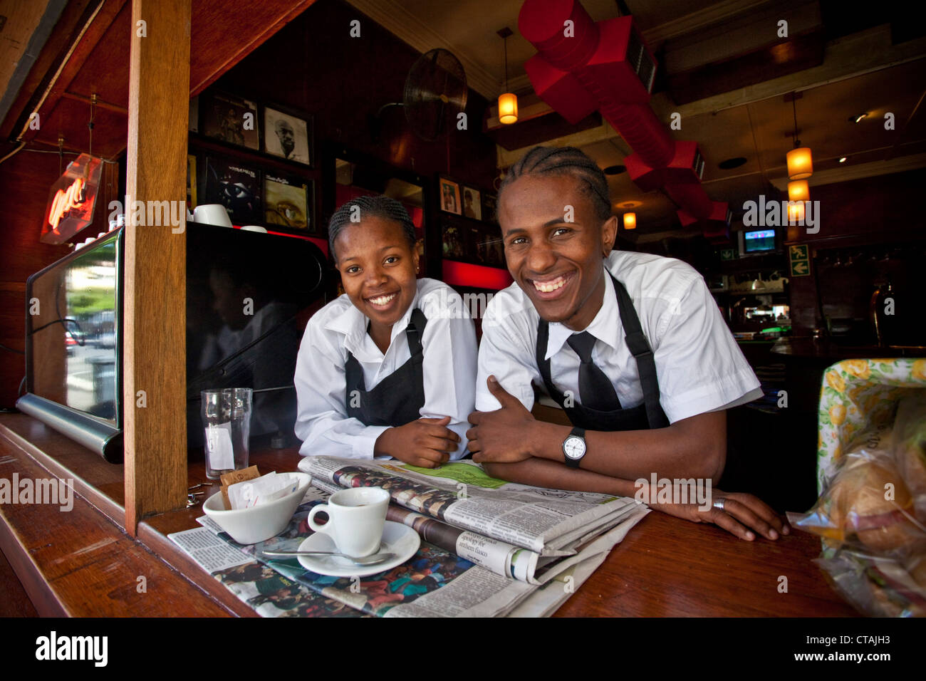 Two waiters at a coffee shop on Long Street, Cape Town, Western Cape, South Africa - Stock Image