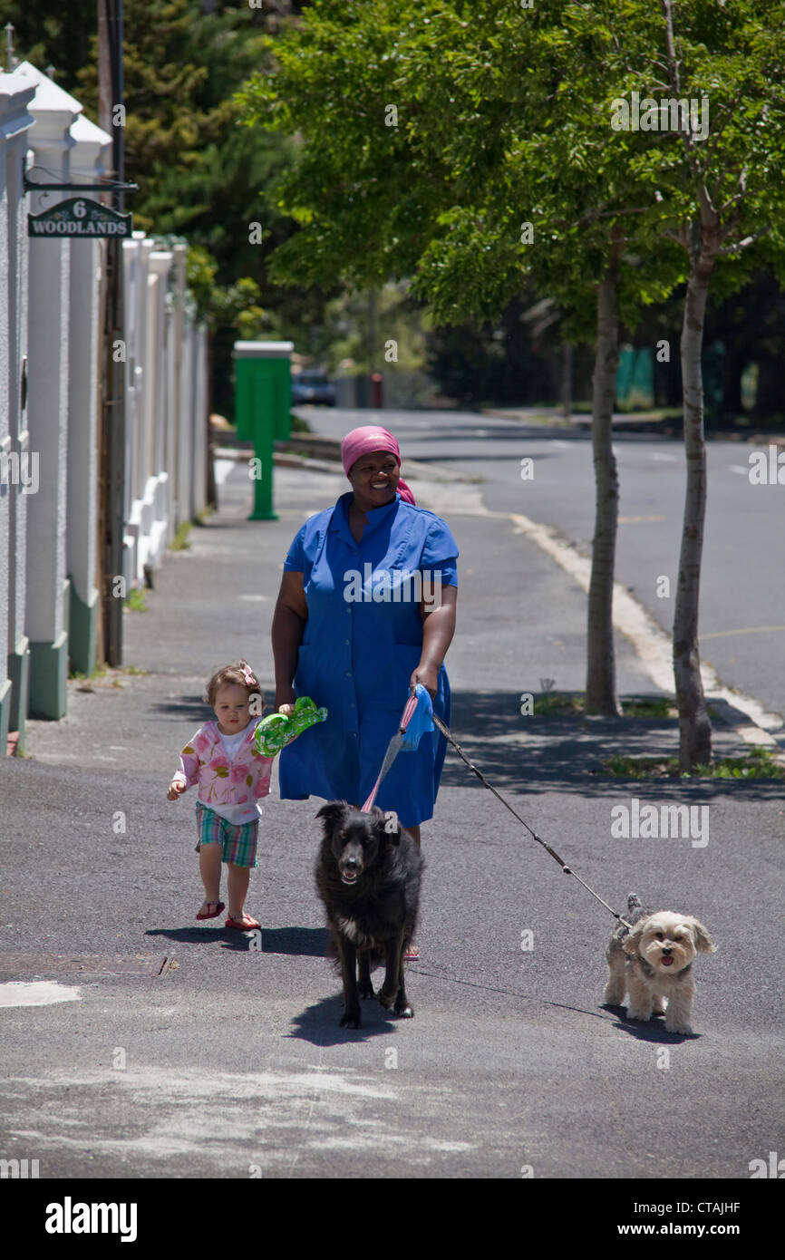Nanny with child and dog on a stroll, Cape Town, Western Cape, South Africa - Stock Image