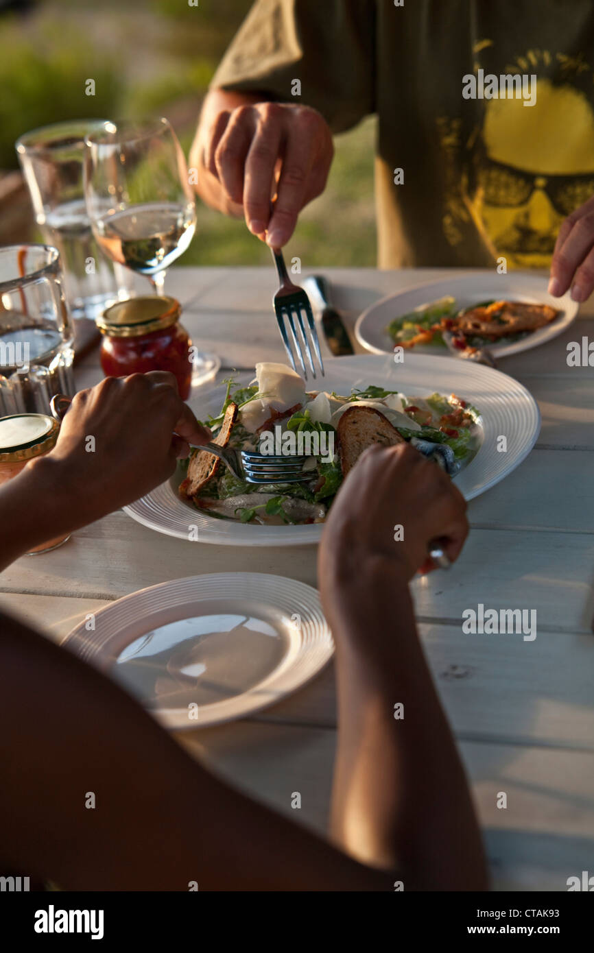 Man and woman eating a bread salad, Restaurant Roundhouse, Camps Bay, Cape Town, Western Cape, South Africa, RSA, - Stock Image