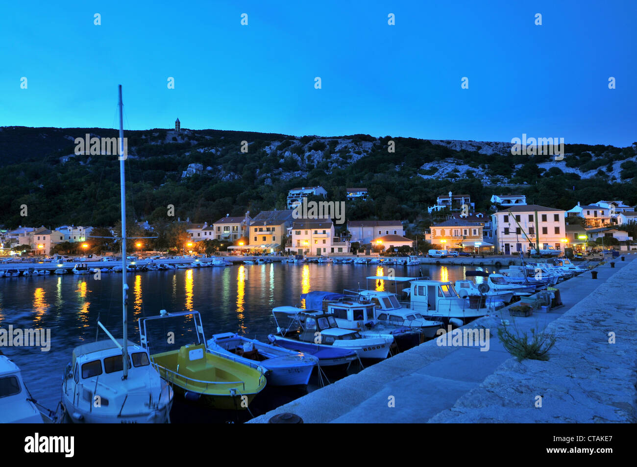 Baska harbour at night, Krk Island, Kvarnen Gulf, Croatia - Stock Image