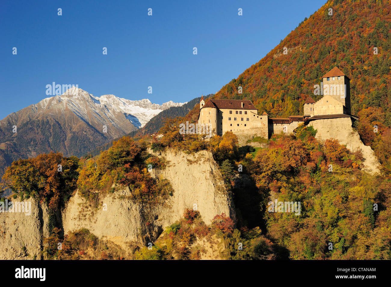Castle Schloss Tirol with mountains in autumn colours and Texel range in background, Schloss Tirol, Meran, South - Stock Image