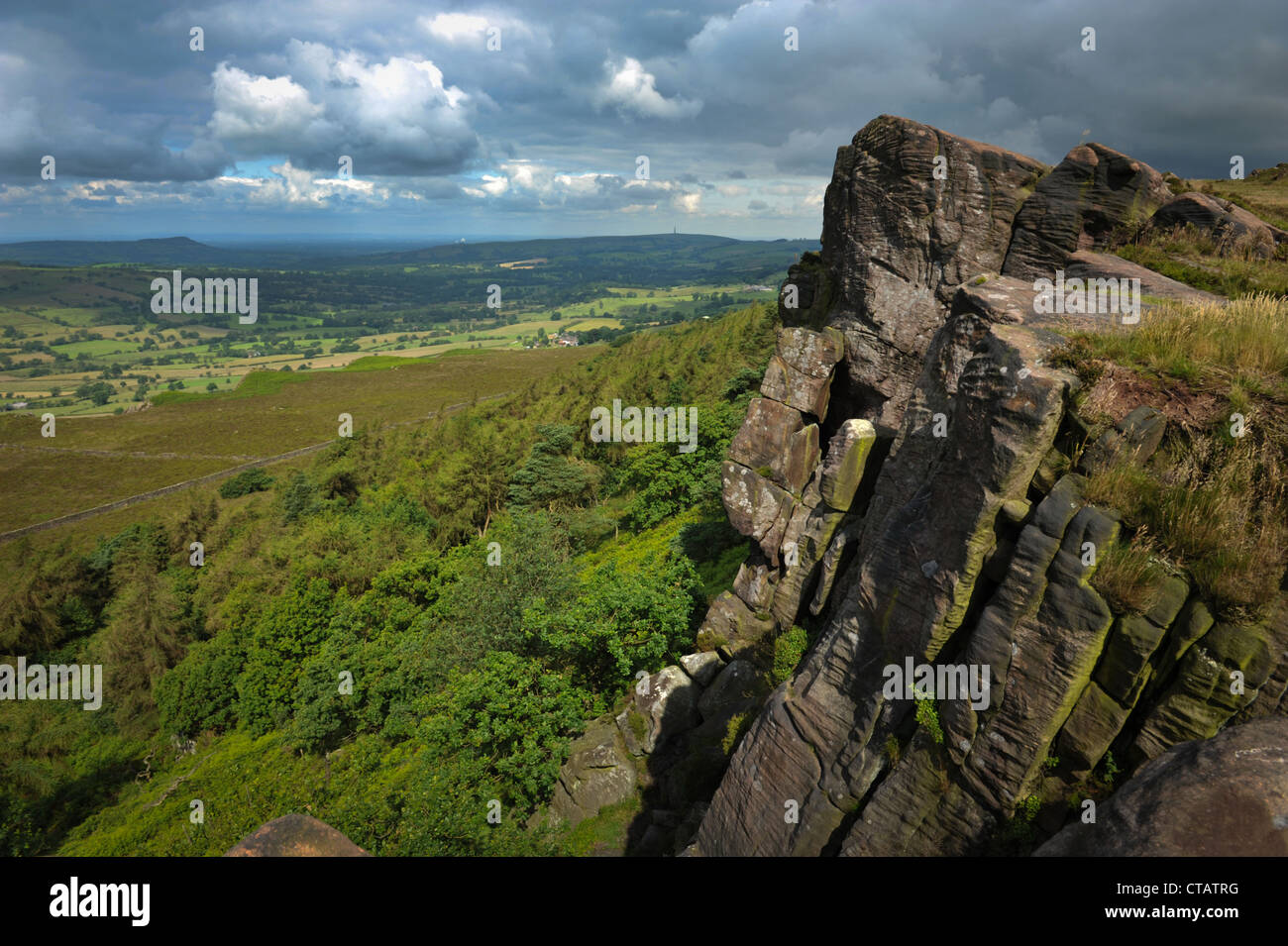 Gritstone rock formations at the Roaches, Peak District National Park, England. Views across North Staffordshire - Stock Image