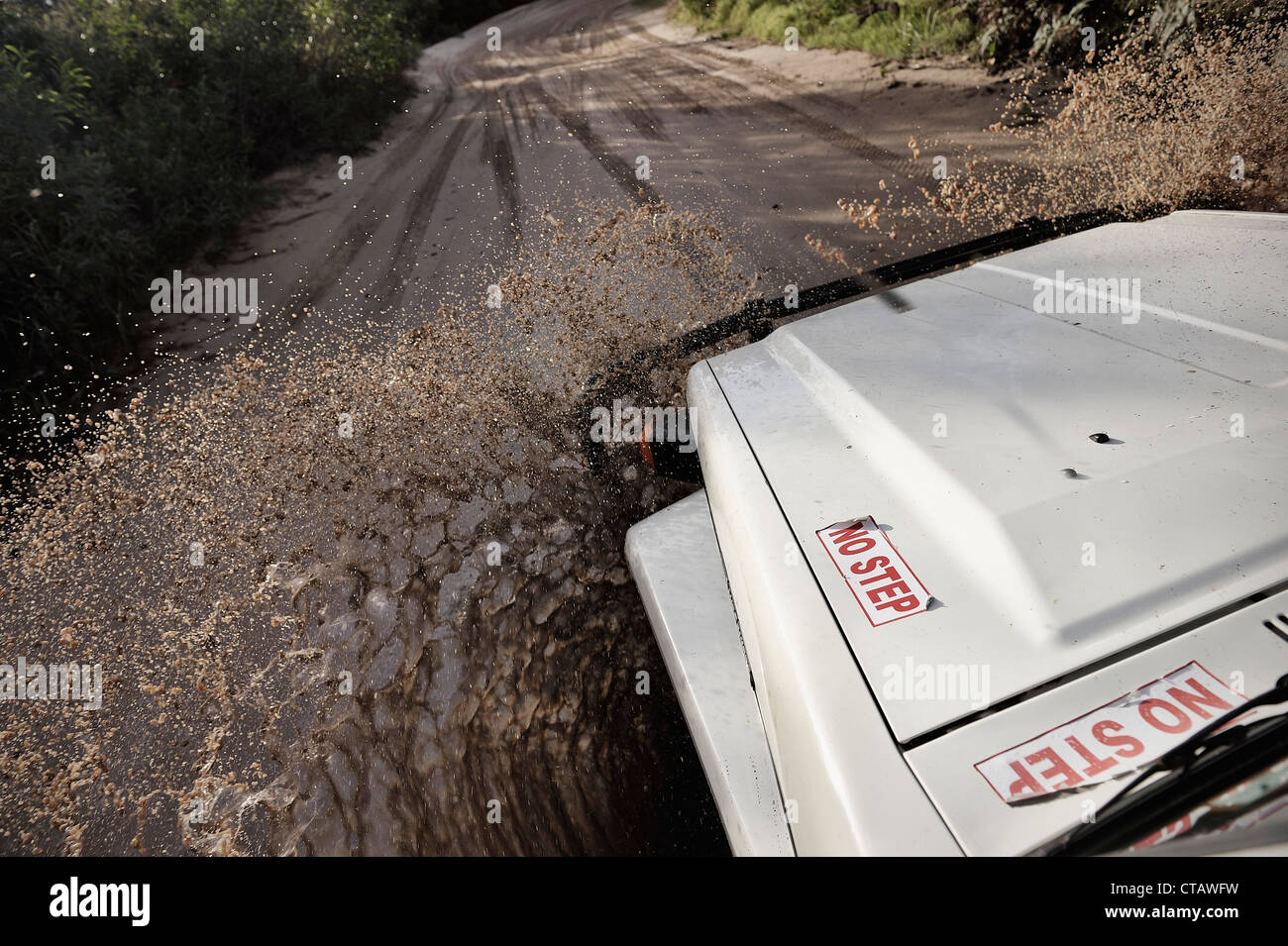 Water creek drivethrough with offroad vehicle 4wd, Fraser Island, UNESCO World Nature Site, Queensland, Australia - Stock Image
