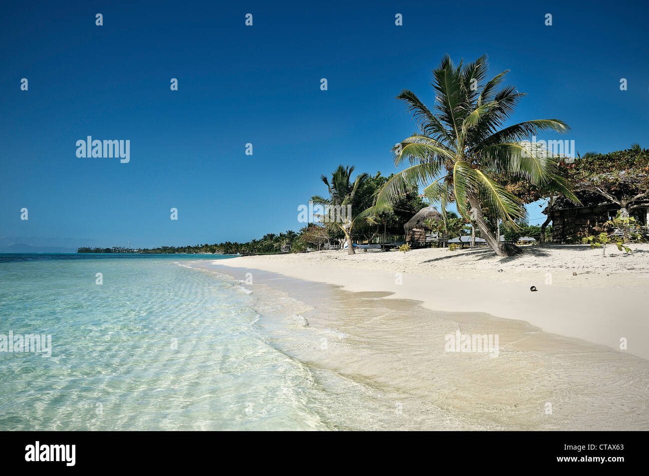white sandy beach with clear water, stunning southern pacific beach, Savaii, Samoa - Stock Image
