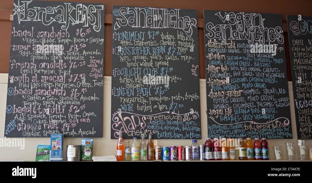 A chalkboard menu offers many choices for those who are hungry. - Stock Image