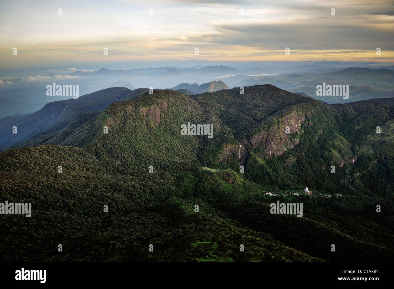 Sunrise at pilgrim sight Adams Peak Sri Pada, view at the surrounding mountains, stupa and waterfall, hill country, - Stock Image