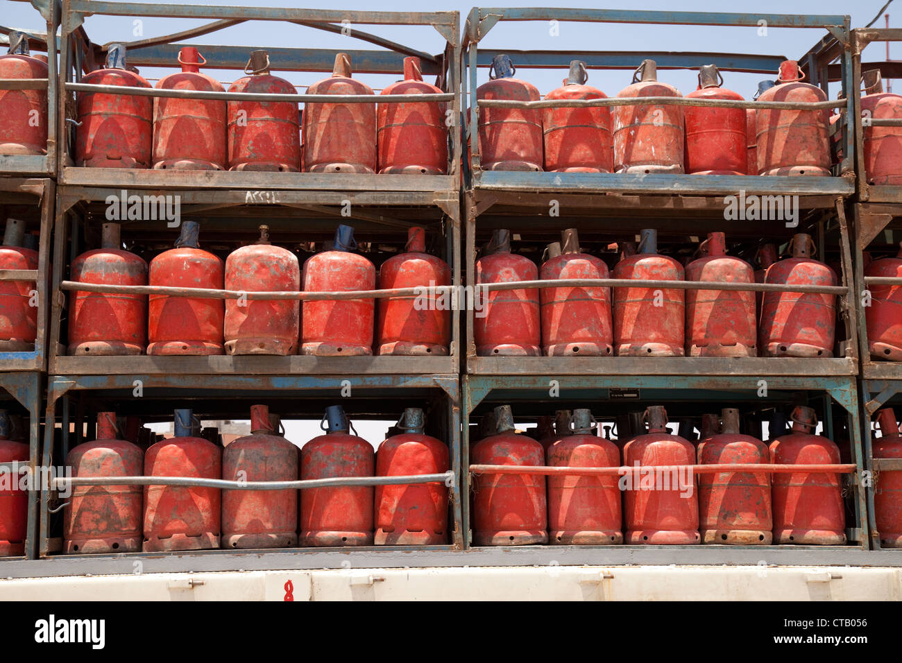 Red propane bottled gas cylinders, Morocco Africa - Stock Image