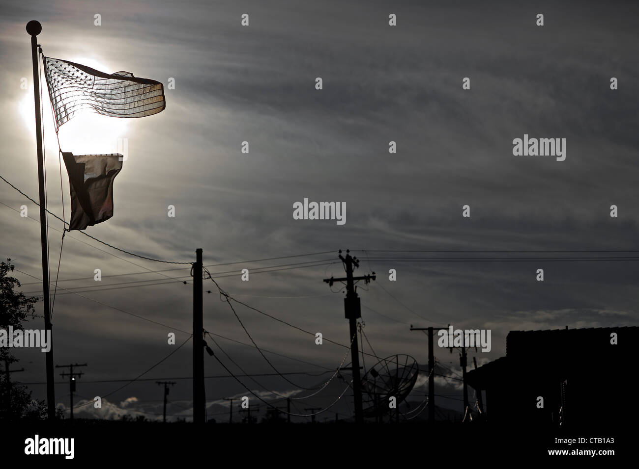 Flagpole in front of the sun, Joshua Tree National Park, California, USA - Stock Image